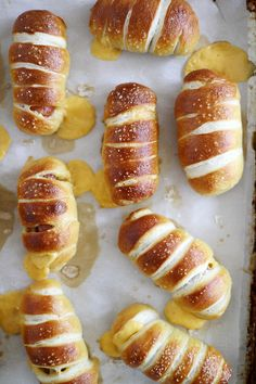 Mini Cheesy Pretzel Dogs. Bite sized hotdogs wrapped in soft pretzels and stuffed with cheese. OMG.