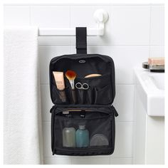 You can hang this toiletry bag, which has handy compartments for smaller items. Toiletry Bag, Travel Accessories, Backpacks, Bags, Products, Do Your Thing, Black, Little Things