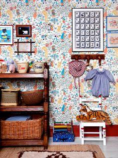 In This Little Boy's Cottagecore Nursery, Old School Beats New School Boys Wallpaper, Nursery Wallpaper, Wallpaper Ideas, London Kids, Nursing Chair, Antique Armoire, Turbulence Deco, Cottage Style, Alice In Wonderland