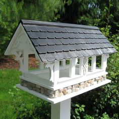 This Signature Series Covered Bridge Bird Feeder is not mounted and does not come with a pedestal. Description from atgstores.com. I searched for this on bing.com/images