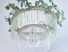 Chandelier inspired by Madame Curie is the brainiest light fixture we've seen