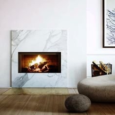 Marble fireplace with copper detailing.