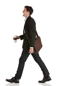 Businessman walking with a disposable cup stock photo