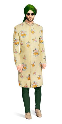 Tiago The Lime Matka Silk fabric is adorned with floral motifs embroidered in the ethnic and western styles of French Knots, Satin Stitches and Ari. This ensemble includes a green Churidaar made from pure cotton.