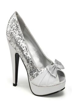 The features include a glitter upper with a pleated satin strap vamp, bow tie accent, peep toe, smooth faux leather lining, and cushioned footbed. 4 1/2 inch heels and 1 inch platforms. PLEASE NOTE: THERE IS A 15% RESTOCKING FEE FOR RETURNS. PLEASE NOTE: Due to the popularity of this item it may take an additional 4 day for processing of this item. 2 Day shipping will not expedite this only the shipping time. For more information please see our Store Policy.