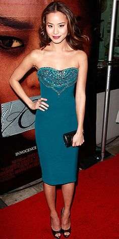 Jamie Chung in strapless teal Notte by Marchesa dress with beaded details at the Beverly Hills premiere of 'Eden'