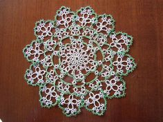 Tatting www.embroiderersguildwa.org.au640 × 480.  CHARACTERISTICS • Appearance - like snowflakes or star shapes • Design - knotted rings, often with picots - smaller rings connected to form large circles, ovals or other shapes • Stitches - one knot, the lark's head