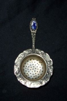 Vintage Tea Strainer: Never saw one with a jewel embellishment before.