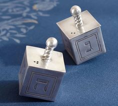 Looking for a great Hanukkah hostess gift? Our Dreidel Salt & Pepper Set is perfect.