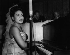Hazel Scott (with Paul Robeson in the background) performing at a dinner in Brooklyn in honor of Hugh Mulzac, the first African American captain in the U.S. Navy to command an integrated crew during World War II. Photo: Joseph Schwartz/Corbis.