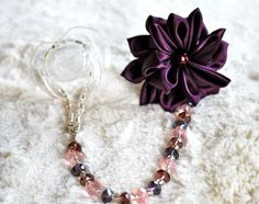 Gorgeous Baby Boutique 4-in-1 Beaded Pacifier Holder. $21.99, via Etsy.