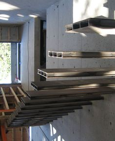finished cantilevered stair, wrapped in wood veneer