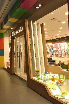 Karamela children clothing store OSO Architects Istanbul 08 Karamela children clothing store by OSO Architects, Istanbul Kids Toy Store, Baby Store, Retail Store Design, Retail Shop, Visual Merchandising, Trade Center, Retail Facade, Kids Clothes Patterns, Shop Interior Design