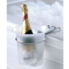 "The Bathtub Champagne Chiller -     This is the bucket chiller that clamps to the side of a bathtub and keeps champagne or wine on ice while you bathe. The 7""-diameter frosted acrylic bucket holds a full size champagne or wine bottle and helps keep it cold and within reach as you relax or celebrate."