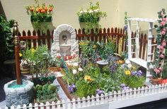Dollhouse garden.  what a cute idea!