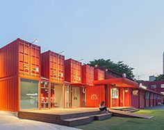 URBANTAINER extend the national theater company of korea with modulated red shipping containers