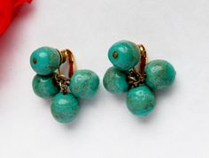 Vogue designer glass bead cluster clip on earrings circa 1950s vintage turquoise beads with gold glitter by KernowGems on Etsy https://www.etsy.com/listing/159031670/vogue-designer-glass-bead-cluster-clip