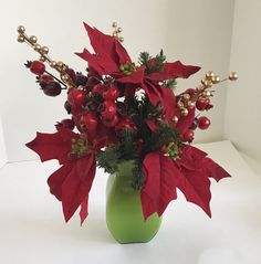 Red Poinsettias with Red and Gold Berries Floral Arrangement in a Green Vase