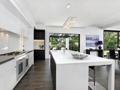 White kitchen with dark timber floors