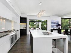 White kitchen with dark timber floors