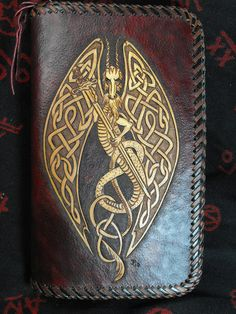 "$125.00. Hand Tooled Leather Celtic Dragon Day Planner by JPsLeather...This is a hand tooled leather day planner. It features a floral Celtic dragon pattern. The inside has several credit card pouches along with an ID window. There are also other areas to put money or whatever....With the zipper going around the outside. dark reddish brown color with saddle tan antique while the edges are laced with a two tone effect. dimensions are 1 1/4"" X 5 1/2"" X 9""."