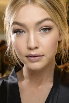 Gigi Hadid wears a messy updo backstage at Dolce & Gabbana's fall 2015 show