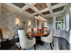 A traditional dining room with boxed ceilings, unique wallpaper and chandelier. Orono, MN Coldwell Banker Burnet $2,995,000