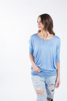 Soft and stretchy top featuring a dolman 3/4 sleeve fitted waist for versatile wear.96% Rayon Modal 4% Spandex #agnesanddora