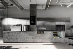 Designed by local architect studio Ritz & Ghougassian, the Penta Cafe in Melbourne's Elsternwick is very raw and minimal. Industrial atmosphere with grey floors, concrete walls, terrazzo benche Cafe Interior Design, Cafe Design, Interior Architecture, Design Art, Design Ideas, Graphic Design, Melbourne Cafe, Melbourne Australia, Vic Australia