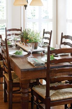 Vintage French Soul ~ A rustic wooden table paired with traditional ladder-back chairs looks classic and fresh. Table And Chairs, Dining Table, Dining Decor, Room Chairs, Rustic Wooden Table, Wood Table, Traditional Dining Rooms, Ladder Back Chairs, Farmhouse Table