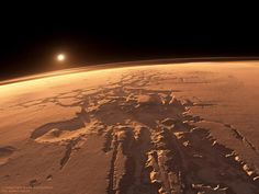 """Noctis Labyrinthus, or the """"Labyrinth of the Night."""" Sol's largest system of intersecting canyons, this foreboding landscape is reputed to be the location of the lost Black City."""
