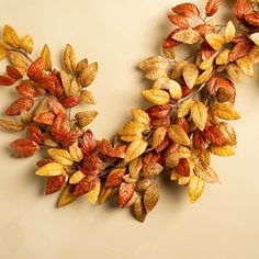 Bring the warm colors of autumn foliage indoors with the Golden Tones Leaf Garland. Faux branches of tapered leaves in russet, ochre, and garnet are woven together to create a look reminiscent of a fine fall day. Fall Leaf Garland, Floral Garland, Cute Fall Wallpaper, Wallpaper Ideas, Fall Fireplace, Thanksgiving Decorations, Autumn Decorations, Fall Home Decor, Fall Wreaths