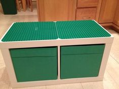 Ikea Expedit two cube unit, Ikea storage containers, two Duplo bases and two tubes of epoxy glue.... One super awesome Duplo table! My husband rocks! by lois