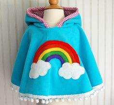 There's also an American Girl doll version to match. Rainbow Poncho Cape in Aqua with Pink Heart Hood  by thetrendytot