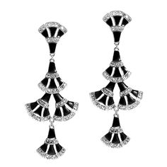 Art Deco is alive and well in these Eunice dangle earrings. Made of five black enamel fans and white diamond crystals set in silvertone metal.   https://chic.kitsylane.com/index.php?file=sale=116=4Y0pK1R