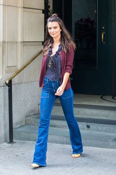 Wear high-waisted denim flares with a simple blouse and fitted cardigan to work.