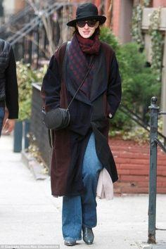 Anne Hathaway wearing Alexander McQueen Upside-Down Skull Muffler Scarf and Valentino Logo-Go Small Calfskin Crossbody Bag