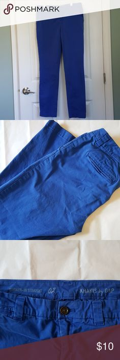"Gap blue khakis size 2 These are made to look ""broken in"", worn several times, great condition,  beautiful color.  I'd say they fit more like a 4 than a 2 because these are a more relaxed fit. GAP Pants Straight Leg"