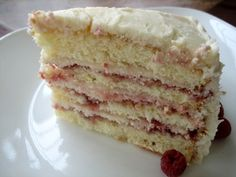 Perfect Party Cake by browneyedbaker:  The flavors (orange, lemon, raspberry, coconut) complemented each other perfectly and the result was an extremely moist and fluffy cake with both a light taste and texture. It would be hard to think of a better cake for a spring or summer special occasion! #Cake #Party