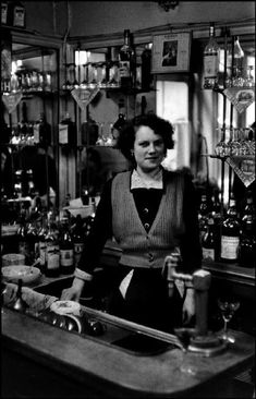 This woman works behind the bar and looks pretty happy about it too. I like this portrait as it tells a lot about the woman and what she does for her job. Paris Photography, Vintage Photography, Inge Morath, Rebecca Miller, Eugene Atget, George Hurrell, Old Paris, Vogue, New York