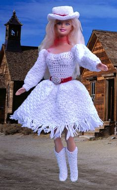 "This doll is a tribute to Betty Hutton as Annie Oakley in the movie ""Annie Get Your Gun."" Her costume is created with white size 10 cotton crochet thread. Her belt is created with red and silver cotton crochet thread. She is trimmed with a red scarf.  This doll includes: •One doll from the Barbie and Friends Collection •Dress as described above •Hat •Scarf •Boots http://www.gayleesdollhouse.com/fantasy/cinema/annieOakley.html"