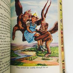Flying Monkeys Carrying Dorothy Away - Color Illustration from Vintage The Wizard of Oz by L. Frank Baum