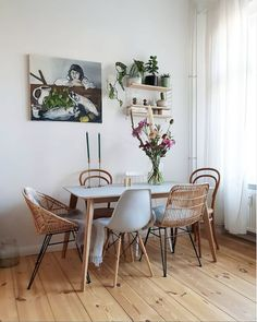 Relaxed dining area with mix match chairs in a Lovely Understated Warm and Inv