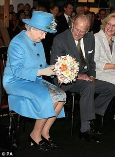 The Queen was accompanied by the Duke of Edinburgh on her visit to the museum, where she was presented with a technology themed bouquet of flowers.