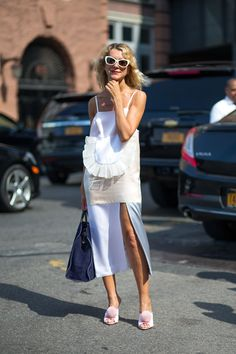 Natalie Joos at NYFW with her navy suede simple tote.