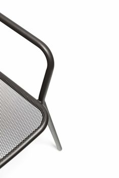 Bent steel (powder-coated) and metal mesh on this chair intended for outdoor use. The Starling collection by Belgian designers Studio Segers.