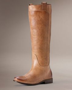 <p>The Vintage Paige Tall Riding Boot from Frye is dressed in the finest vintage leather. A boot top panel rides up from foot to just below the knee, while the shaft and pull tabs rise higher still. At the back a split relaxes the shaft just so. This legendary style is handcrafted from vegetable tanned leathers to Frye's exacting standards.<br><br>Frye has been dedicated to celebrating quality craftsmanship and vintage American roots since 1863. Each and every Frye boot is made from the ...