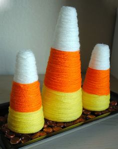 20 Spooktacular DIY Halloween Decorations: Yarn Wrapped Candy Corn Decorations
