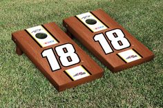 Our NASCAR KYLE BUSCH #18 CORNHOLE GAME SET ROSEWOOD STAINED STRIPE VERSION. Get your custom set at victorytailgate.com