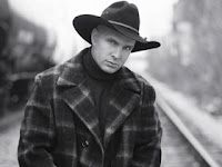 Garth Brooks is the son of Troyal and Colleen Carroll Brooks. Colleen was a country singer herself, recording a handful of records for Capitol in the mid-'50s that never experienced any chart success. As a child, Garth was interested in music but he concentrated on athletics. He received a partial athletic scholarship at Oklahoma State University.  While he was at college, Brooks began singing in local Oklahoma clubs.